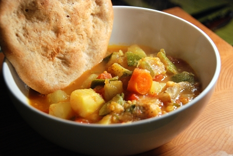 a bowl of bread and veggies
